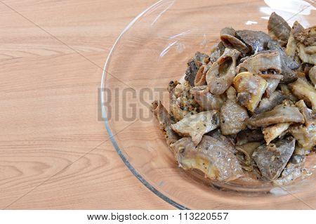 fried pork entrails with garlic on dish