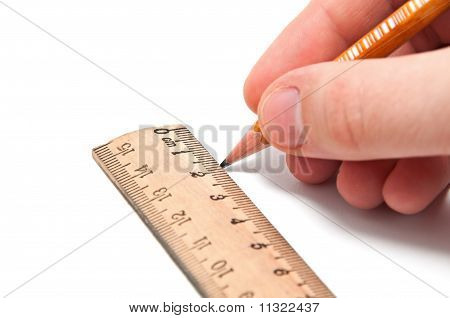 Hand Draws A Line With A Pencil And Ruler