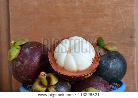 mangosteen peel out on wood table