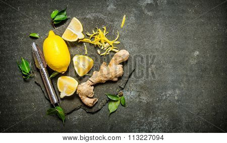 Lemon Zest, Ginger And Leaves On A Stone Stand.
