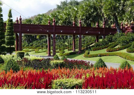 The Asian Style Bridge And Flowerbed