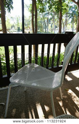 White Metal Chair On The Balcony
