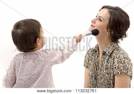 Little Girl Putting On The Makeup To Her Mother