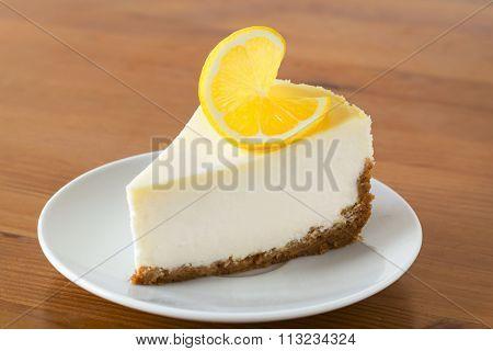 Lemon cheesecake on white plate