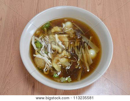 braised fish maw in red gravy on bowl