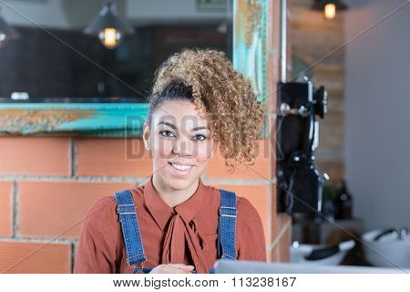 Portrait Of Smiling Woman Working In Bar