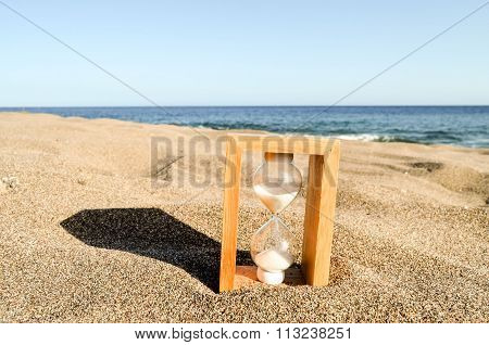 Hourglass Clock on the Sand Beach