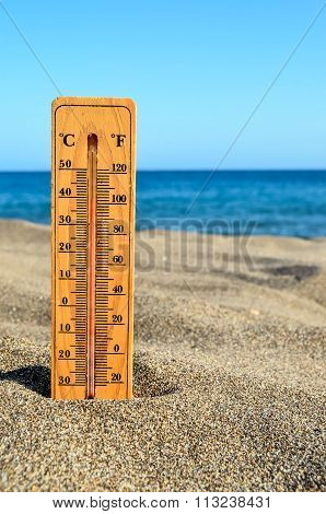 Thermometer on the Sand Beach