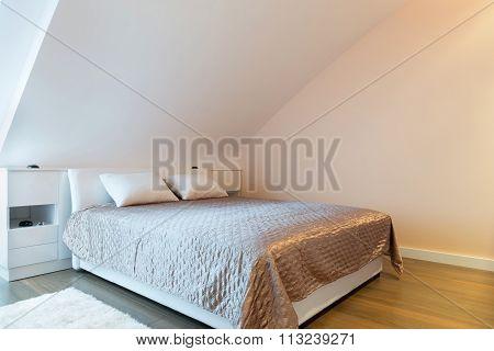 Modern luxury bedroom interior in the attic