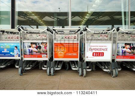 HONG KONG - DECEMBER 24, 2015: baggage trolleys near entrance to Hong Kong Airport. Hong Kong International Airport is the main airport in Hong Kong. It is located on the island of Chek Lap Kok