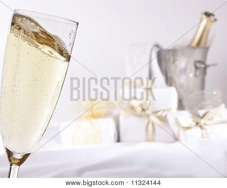 Glass of champagne and gifts
