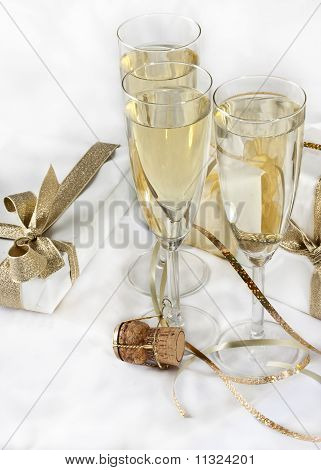 Glasses of champagne and cork