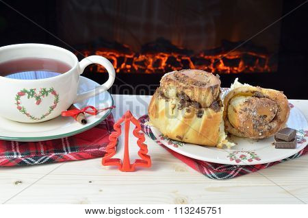 Cinnamon Rolls And Tea By The Fireplace