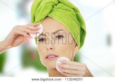 Beautiful caucasian woman with cotton pads.