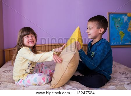 Happy children in a pillow fight