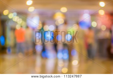 Blur Image Of Long Empty Corridor On Night Time With Bokeh.