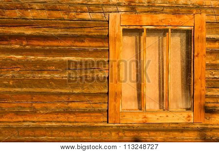 timbered wall of a village house with a window background