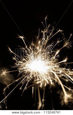 Lighted Sparkler On A Balck Background (soft Focus)