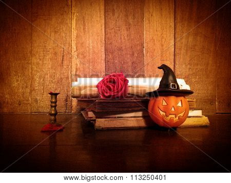Pumpkin Doll And Old Books On Wooden Background