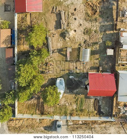 Aerial view on ground plot with cottage. Russia