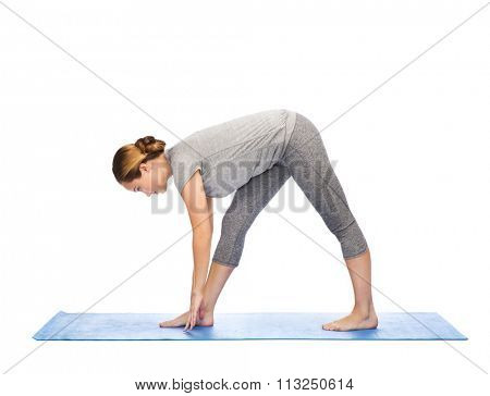woman making yoga intense stretch pose on mat