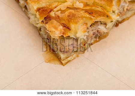 Closeup of cake with chicken meat.