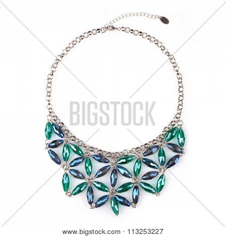 Silver necklace with blue and green rhinestones, isolated on white. A rhinestone or diamante is a diamond simulant made from rock crystal, glass or acrylic