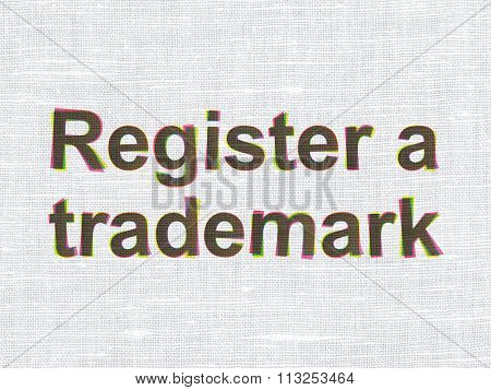 Law concept: Register A Trademark on fabric texture background