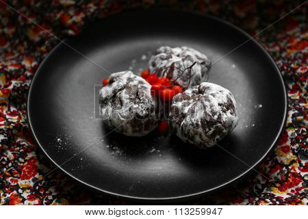 Chocolate balls with ash berry on fabric background
