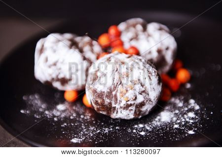 Chocolate balls with ash berry closeup