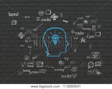 Advertising concept: Head With Lightbulb on wall background