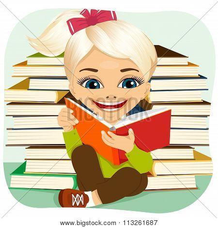 little blonde girl reading an interesting book