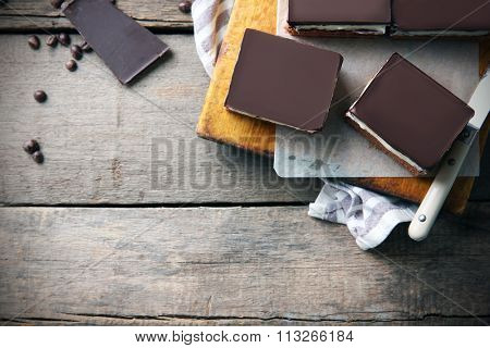 Delicious chocolate brownies on wooden background