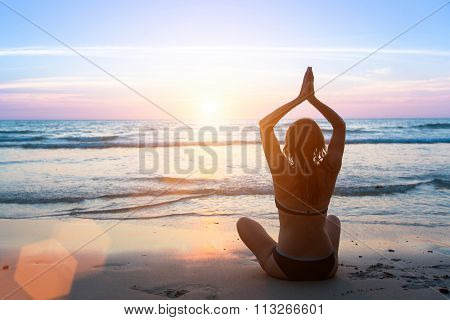 Serenity and yoga practicing at sunset, meditation female silhouette.