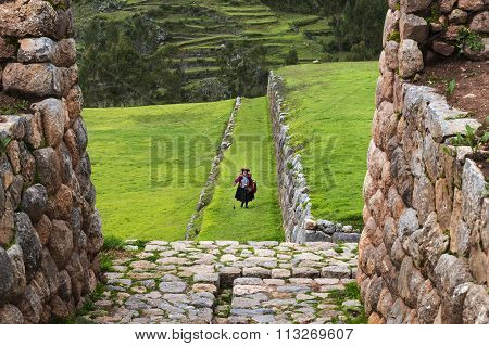 Peruvian woman in the Inca Ruins in the village of Chinchero in Peru.