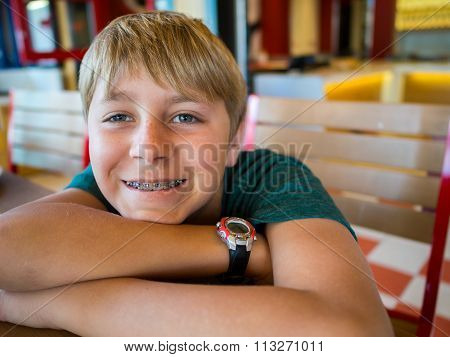 Close up portrait of smiling teenage boy