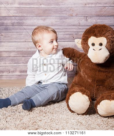 Baby Boy With Huge Monkey Toy