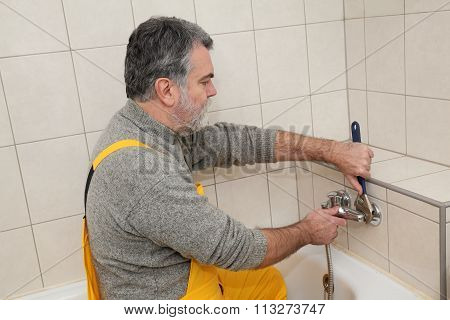 Plumber Works In A Bathroom Bath Toob Faucet Fixing