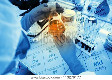 Doctor Holding A Test Tube, A Flask With Liquid In Special Laboratory Preparing For Experiments And