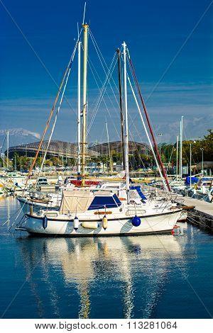 Sailing boats in marine with stadium Poljud in background, Croatia.
