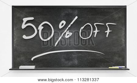 Fifty per cent off written on blackboard