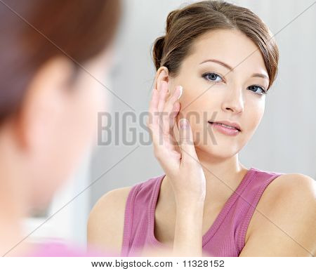 Woman Caring Of Her  Beautiful Skin On The  Face