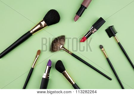 Different Cosmetics On Green Background