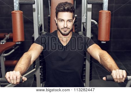Man Workout On Horizontal Pressing Machine