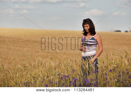 Mid Adult Women in a field with flowers