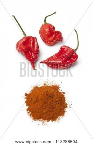 Fresh red hot scorpion chili peppers and chili powder on white background