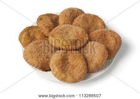 Heap of sugared fried apple fritters or appelflappen on a dish on white background