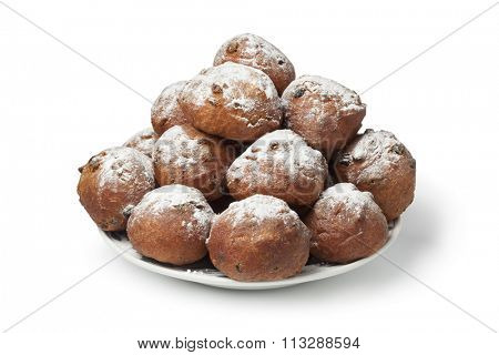 Heap of sugared fried fritters or oliebollen on white background