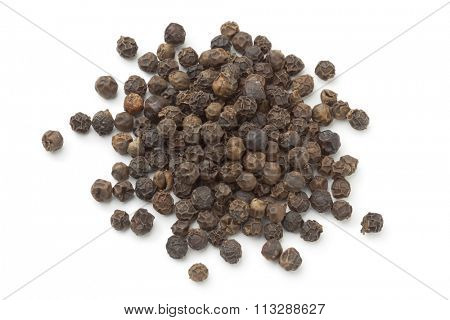 Heap of black peppercorns on white background