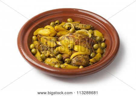 Traditional moroccan tajine with chicken,potatoes and olives on white background